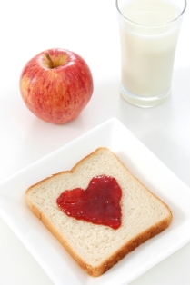 Apple, glass of milk, bread and heart