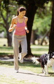 woman running outside wth dog