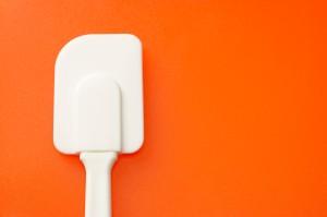 Spatula on an orange background